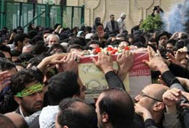 مراسم تشییع پیکر دو شهید گمنام هشت سال دفاع مقدس در تهران